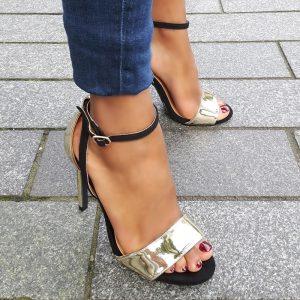 Hoge hakken zwart met goud met brede band over de voet